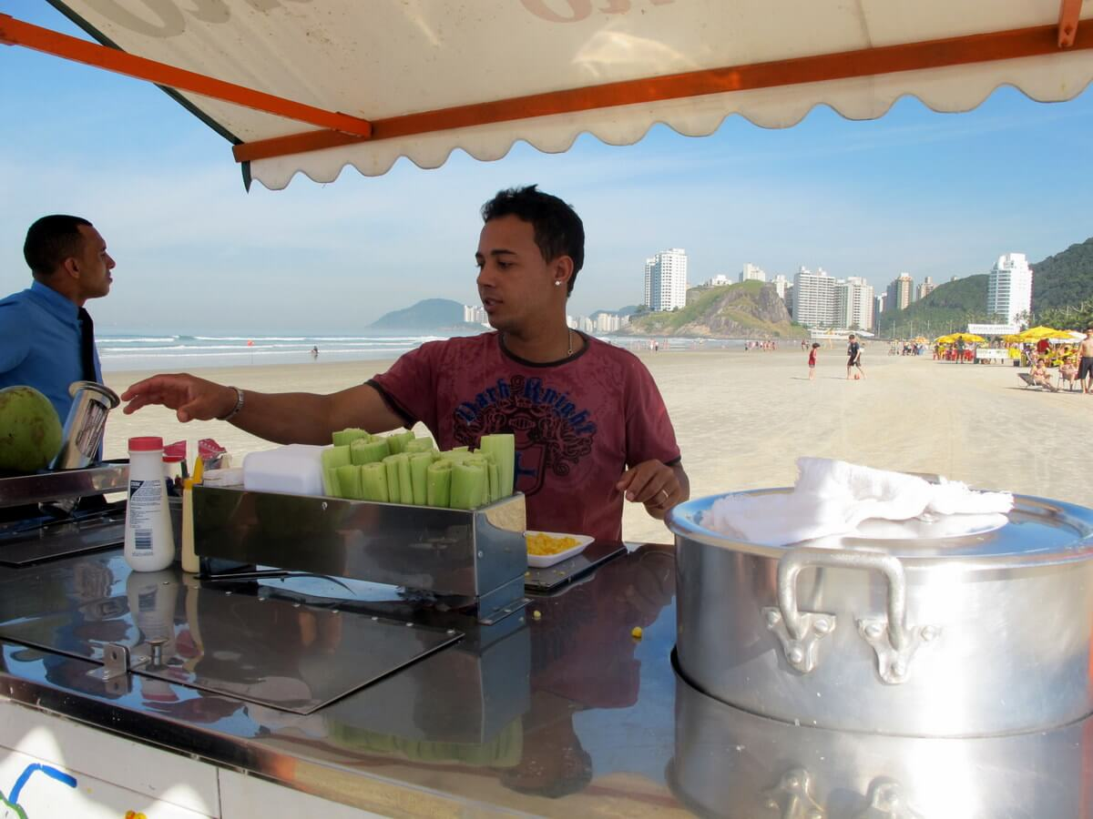 Brazilian strangers often seem like old friends: the friendly coconut and corn vendor on the beach in Guaruja, Brazil