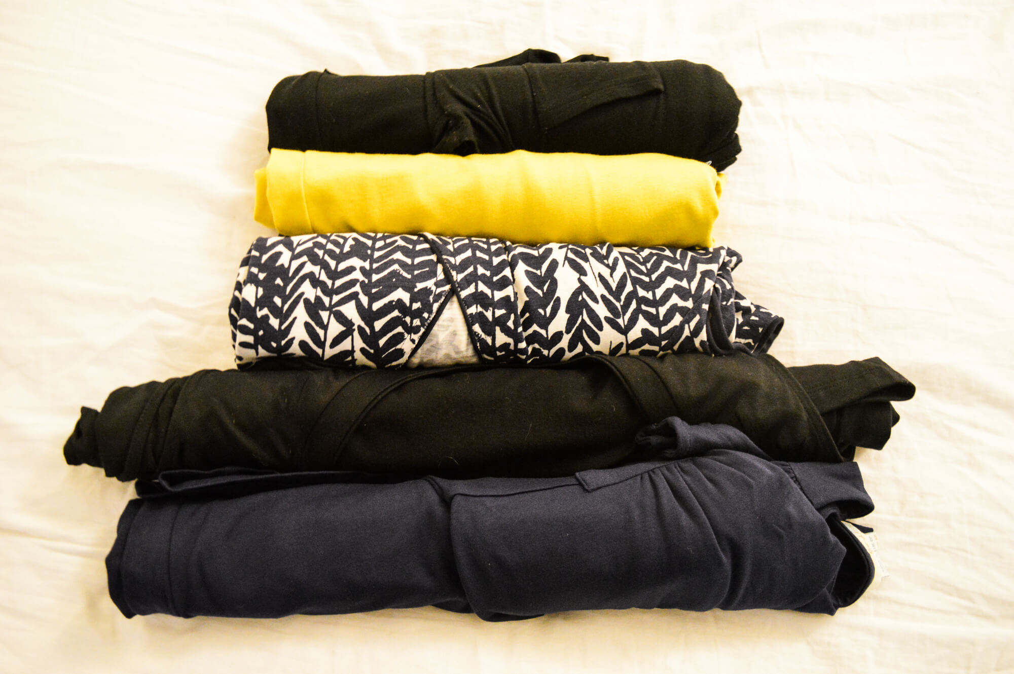 how to roll your clothes for travel